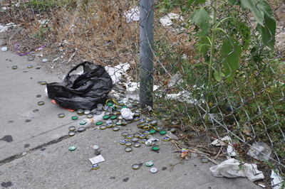 An empty lot on Broadway, between Academy and 204th streets, is often the site of trash accumulations.