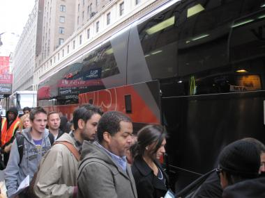 Crowds wait to board a BoltBus at West 33rd and Seventh Avenue.