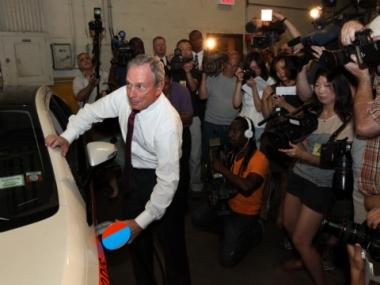 Mayor Michael Bloomberg demonstrated how to charge an electric car July 12, 2011 in Queens.