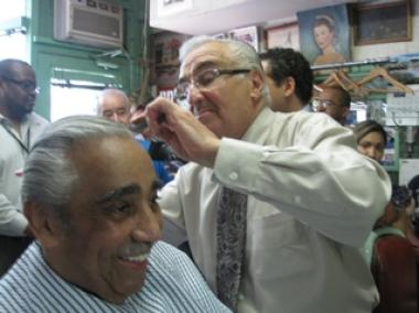 Claudio cuts the hair of Harlem Rep. Charles Rangel who is one of a group of local politicians who have come out to support him.