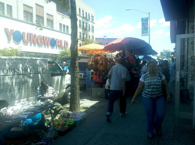 Many residents and shop owners say vendors clog sidewalks and take away sales.