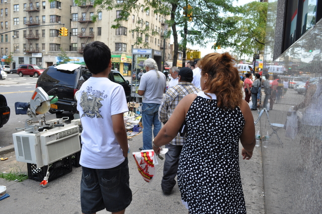 Street vendors make it difficult to navigate the sidewalks, residents say.