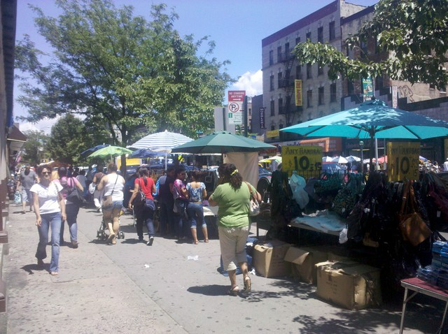 Vendors crowd St. Nicholas Avenue.