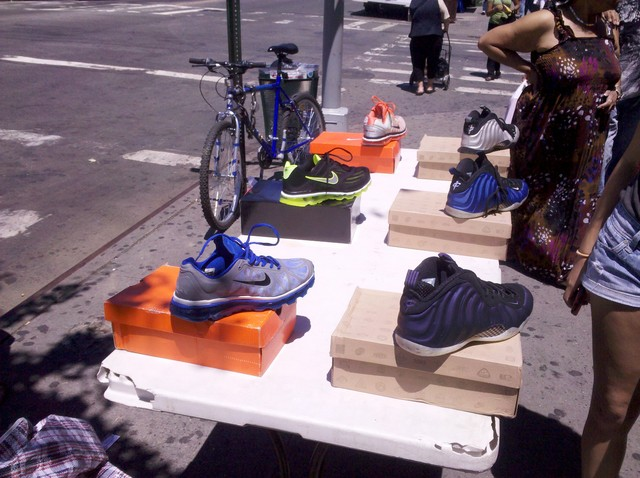 Sneakers are sold on a table on St. Nicholas Avenue.