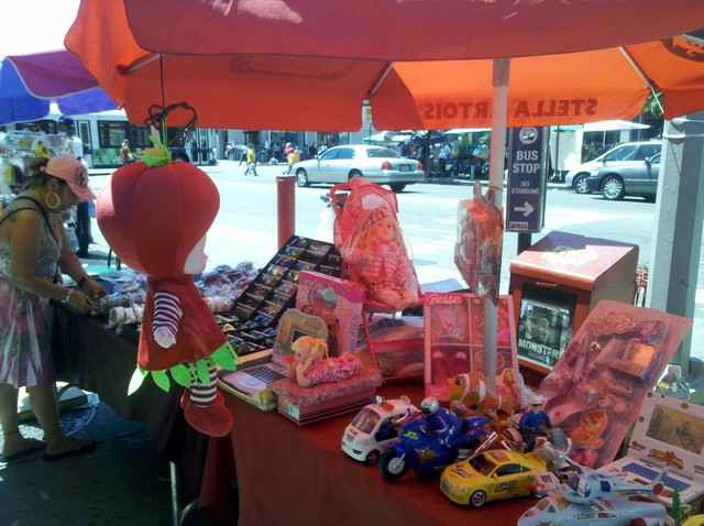Childrens toys are sold at a stand on St. Nicholas Avenue.