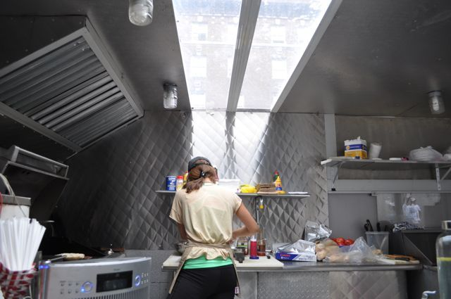 Monnican Cruz makes a chimi inside the new truck, complete with a sun roof.