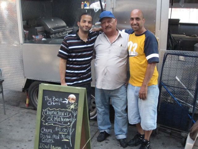 Three generations of the Cruz family make chimis in Inwood. Here are three Manuel Cruzs, from left, grandson, grandfather and father.