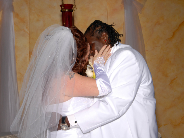 Jeanette Coleman wore a wedding dress, and Kawane Harris a suit in their marriage ceremony in August 2010.