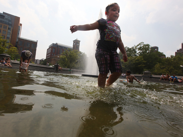 Yarelis Martinez plays in the fountain in Manhattan's Washington Square Park on July 21, 2011.