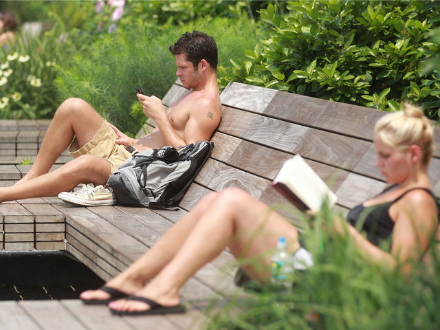 People read in Manhattan's High Line Park on July 21, 2011. The city has kept cooling centers open to help residents beat the heat and humidity.