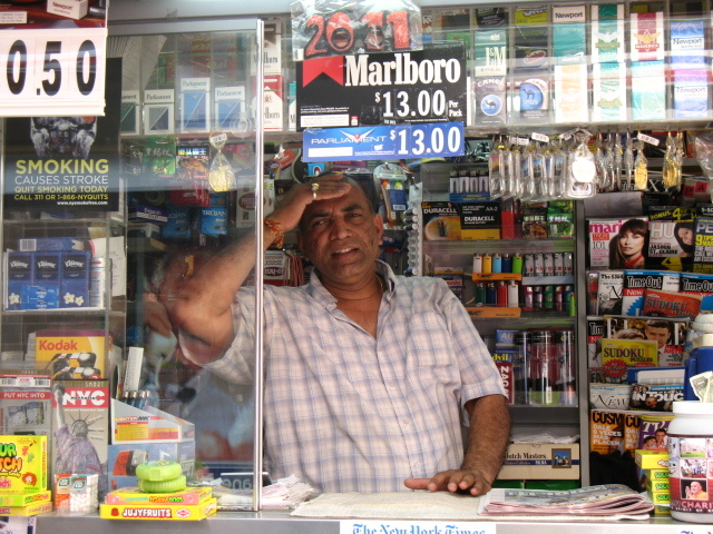 Kirit Patel, 46, wipes the sweat away from his forehead in his newsstand at West 52nd St. and Broadway in Midtown on July 22, 2011. Temperatures are expected to reach 100 degrees.