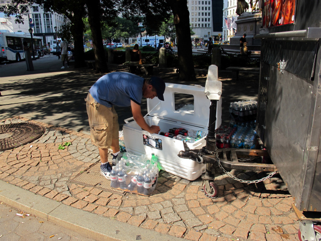 Tashi Gyaltsu, who set up his cart at the entrance to Central Park on 59th Street on Friday, stocked a giant cooler full of cold beverages in preparation for the day's soaring temperatures.