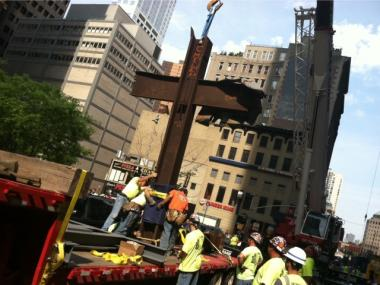Crews prepare the World Trade Center Cross to be lowered into its resting place at the Sept. 11 Memorial on July 23, 2011.