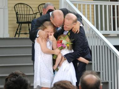 John Feinblatt and Jonathan Mintz embraced their daughters, Maeve and Georgia.