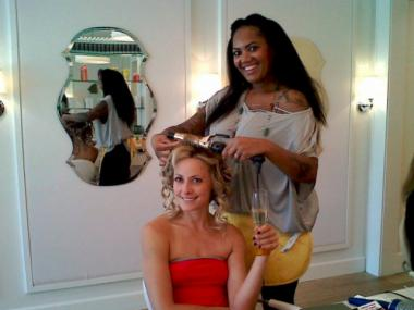 A happy Drybar customer celebrates her birthday with champagne.