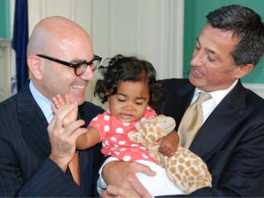The new ACS Commisioner Ronald Richter with his daughter, Maya, and spouse, Franklin Cogliano