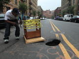 Sinkhole 'Fixed' With Broken Table