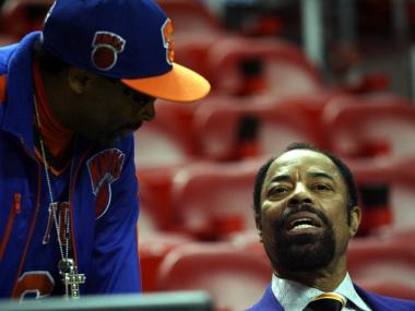NBA Legend Walt Frazier (right) with director Spike Lee at the Miami Heat against the New York Knicks game at American Airlines Arena on December 28, 2010 in Miami, Florida.