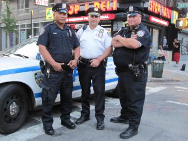 L to R: Officer A. Taeza, 7th Precinct Capt. David Miller and Officer J. Pena at the precinct's National Night Out celebration on Stanton Street on Tues., Aug. 2, 2011.