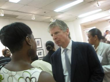 District Attorney Cy Vance speaks with a participant after the forum.