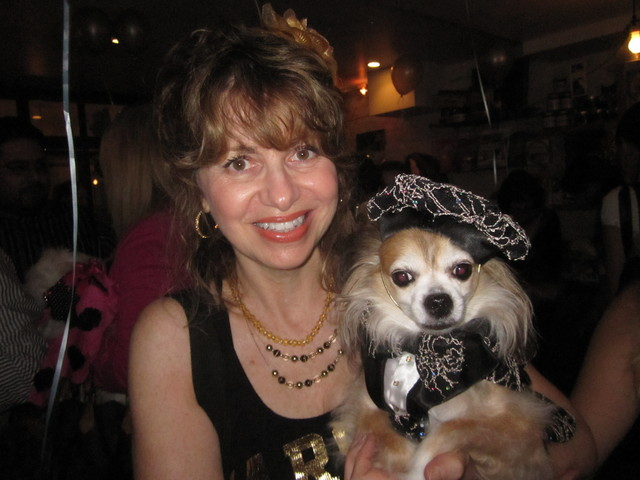 Chico, a long-haired Chihuahua, with owner Stella Panzarino.