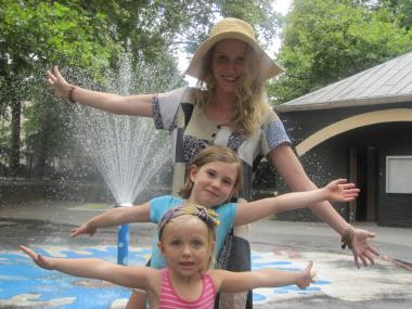 Nanny Sarah Swymer and Lexi and Annie Lee at a playground in Jackie Robinson Park in Harlem.