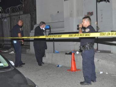 Cops investigate the scene of a shooting at 2269 First Ave., near East 117th Street, on Aug. 13, 2011.  The man's injuries were not life-threatening.