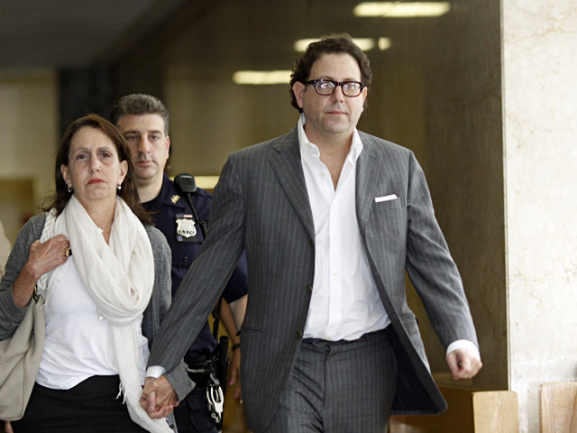 Andrew Albert (r.) and a woman who was identified as his sister leave Manhattan Supreme Court on Aug. 15, 2011.