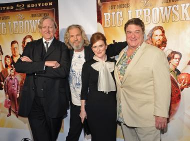 T-Bone Burnett, Jeff Bridges, Julianne Moore, and John Goodman smile for the cameras at the Lebowski reunion.
