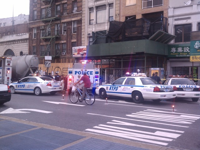 Police investigate the scene where a cyclist was killed on Chrystie and Delancey streets on Aug. 18, 2011.