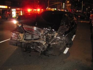 A Lincoln Town Car  sits smashed after a multi-car crash on Second Avenue on Thurs. Aug. 18.