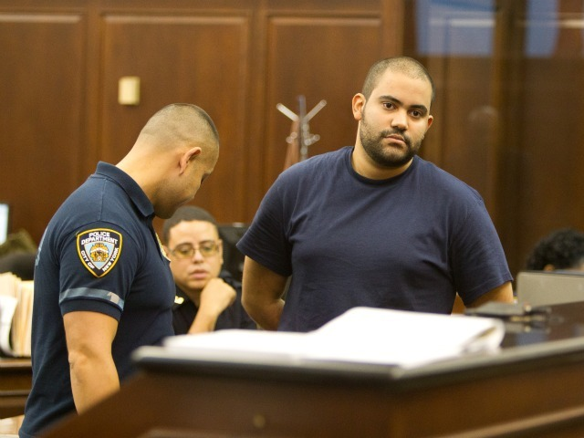 Officer Michael Pena appears in Manhattan Criminal Court on Aug. 20, 2011 for his arraignment on charges of raping a teacher in Inwood the day before.
