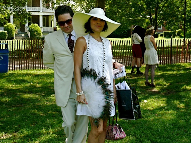 Felix and Morgan in shades of white suited for a lawn party. Her peacock feather fan is the ideal accessory.