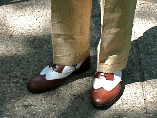 A wonderful example of the slim cut pant no break most popular during the early 20s, paired with a tan and white spectator brogues