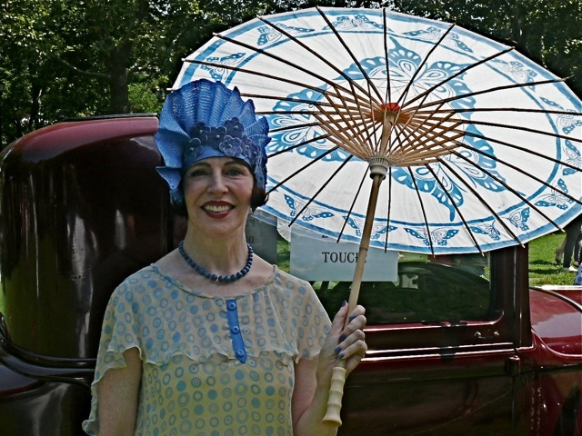 Milliner and designer Gretchen Fenston in a free-form cloche hat, which was another direct reaction to the Art Deco styling of women's fashion.