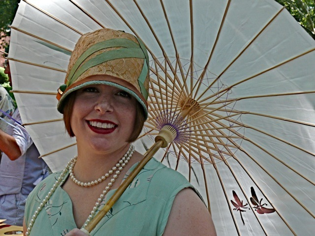 Here is an authentic 1920 cloche hat with sea foam green grosgrain ribbon trim and lace. Her dress was a matching drop waist silhouette