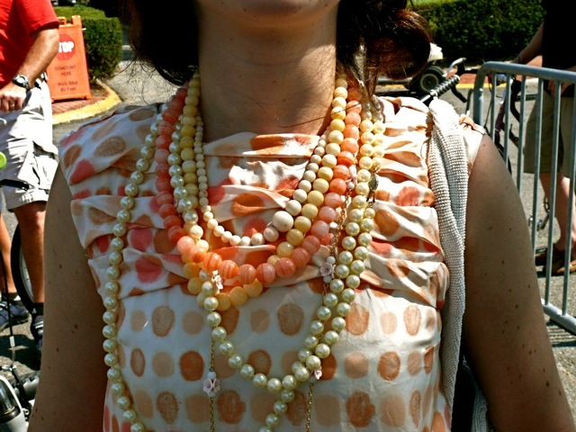 Fashion Stylist Elizabeth Wachstein perfectly paired ropes of pearls citrus glass beads and coral glass beads and ivory colored bobbles against a very pretty vintage dotted drop waist dress