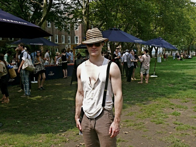 The very hip modern New York dandy approach to vintage inspired men's fashion. His bib front sleeveless Henley shirt worked well with suspenders and brown trousers cropped at ankle length.