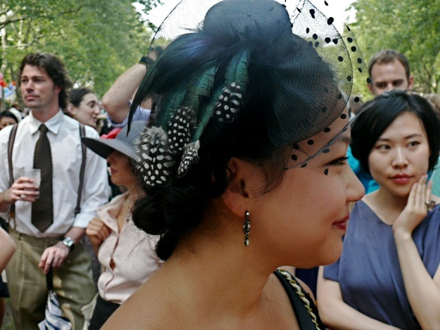 This fascinator was seen at the edge of the dance floor. It has polka dot netting and teal iridescent and dotted feathers