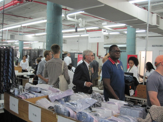 Men waiting in line at the Barneys Warehouse sale.