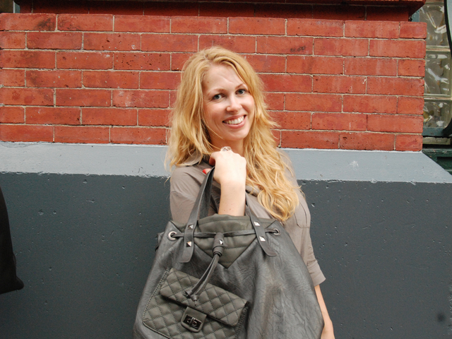 <p>Pernilla Ericson, 31, of Stockholm, poses with her grey leather Barneys bag. She got the bag at a 25 percent discount for $75.</p>