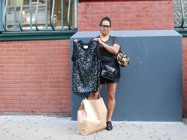 <p>Cindy Gutierrez shows off one item from her bag on goodies. The 39-year-old Bushwick resident got a Phillip Lim sequined top for half off at $293.</p>