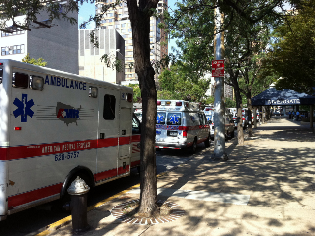 Eleven ambulances were lined on East 34th Street between First Avenue and the East River in anticipation of the evacuation of NYU Hospital on Aug. 26, 2011.
