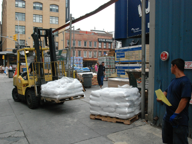 Staff from Prince Lumber in Chelsea load sandbags onto a skid on Aug. 26 as people prepare for Hurricane Irene.