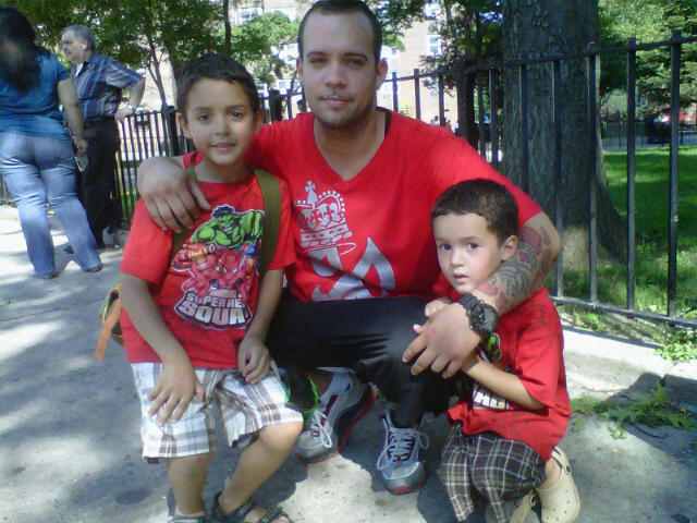 Jacob Riis Houses resident Julio Pinero and his sons Brandon (l.) and Jonathan prepared to leave for the Bronx.