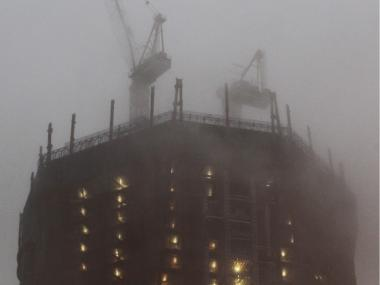 One World Trade Center gets battered by rain during Hurricane Irene early in the morning on Aug. 28, 2011.