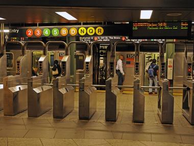 Commuters board the subway in Brooklyn for the Monday morning commute to Manhattan after Hurricane Irene.