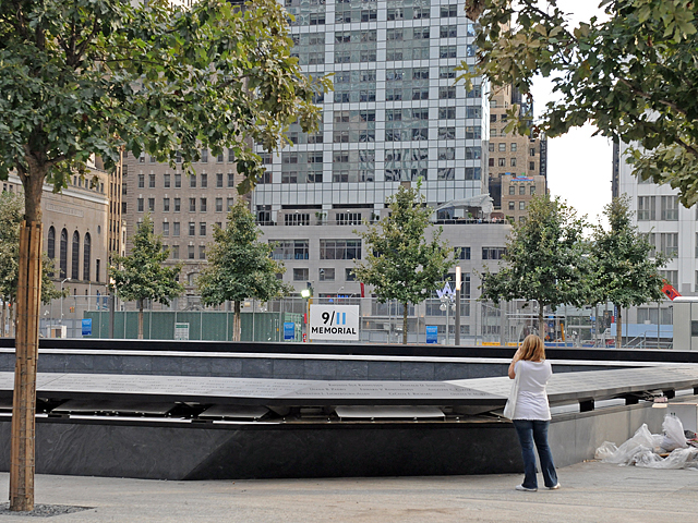 A woman takes a picture of the memorial.