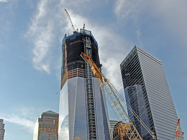 Construction on One World Trade Center will continue after the memorial opens.