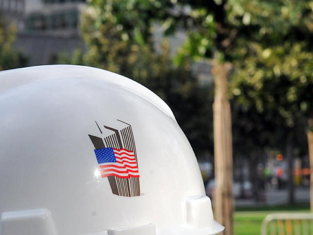 A 9/11 Museum worker wears a hardhat honoring 9/11.